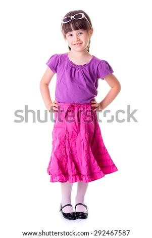 Pretty little girl standing on white in studio - stock photo