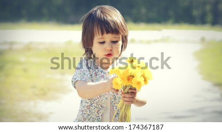Pretty little girl walks in the park - stock photo