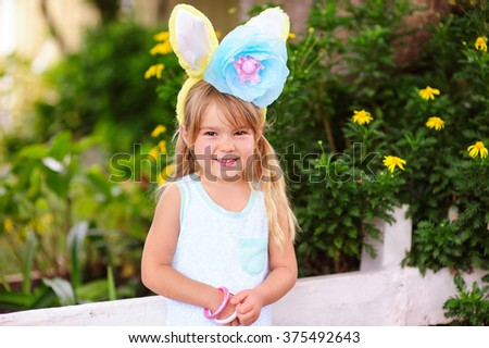 Pretty little girl wearing Easter Hat outdoor - stock photo