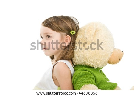 Pretty little girl with big bear isolated on white. - stock photo
