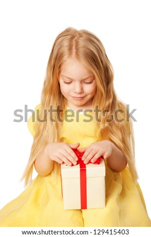 Pretty little girl with gift. Festive concept. Selective focus on a box with a gift.  Isolated on white background - stock photo
