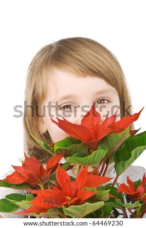 Pretty little girl with red poinsettia - stock photo