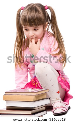 Pretty little girl with stack of books - stock photo