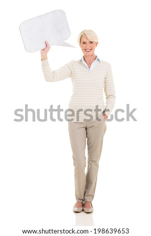 pretty mature woman holding paper speech bubble over white background - stock photo