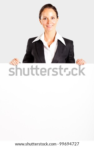 pretty mid age businesswoman behind white board - stock photo