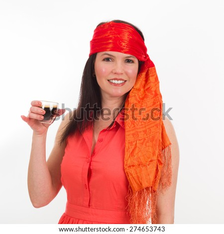 Pretty middle age woman wearing a colorful bandana drinking espresso coffee on a white background. - stock photo