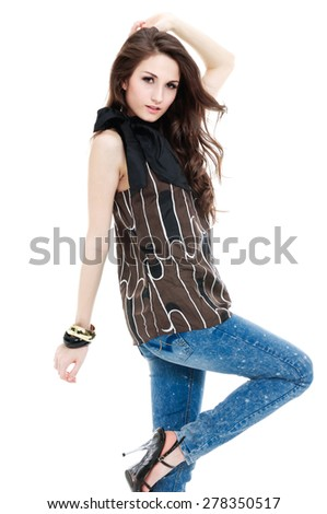 Pretty model in jeans against white background  - stock photo