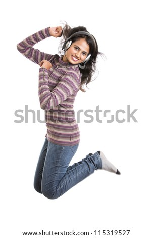 Pretty modern girl jumping with headphone on white. - stock photo