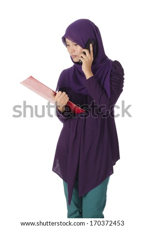Pretty muslim woman model holding a board and phone - stock photo