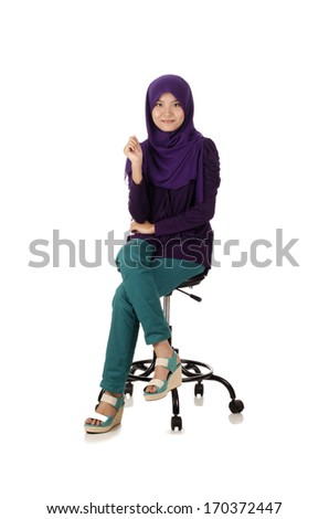 Pretty muslim woman model in action isolated on white - stock photo