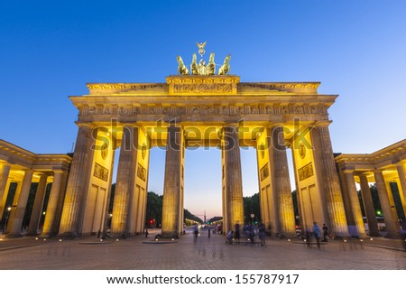 Pretty night time illuminations of the Brandenburg Gate (1788) inspired by Greek architecture, built as a symbol of peace and nationalism, now an emblem of reunification. - stock photo