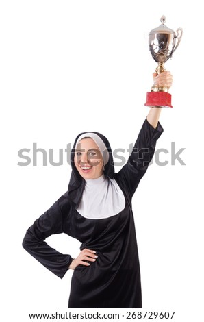 Pretty nun holding winner cup isolated on white - stock photo