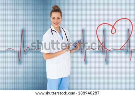 Pretty nurse using tablet pc against medical background with red ecg line - stock photo
