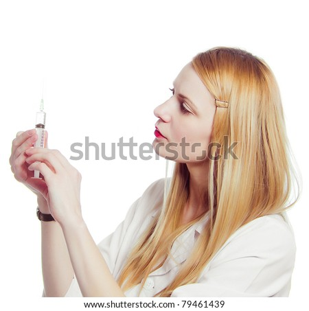 pretty nurse with syringe - stock photo