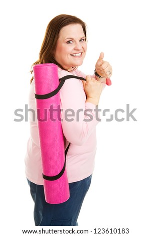 Pretty, overweight woman going to work out with her yoga mat.  Isolated on white. - stock photo