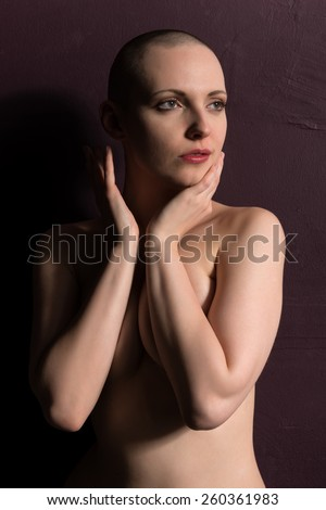 Pretty pale woman with a shaved head - stock photo