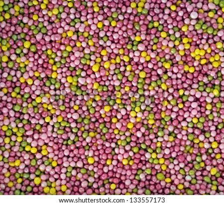 Pretty pastel cake sprinkles macro background - stock photo