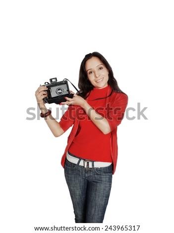 Pretty Photographer holding camera over white. - stock photo