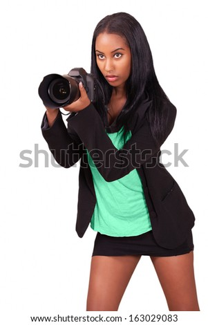 Pretty photographer taking photo, concentrating - stock photo