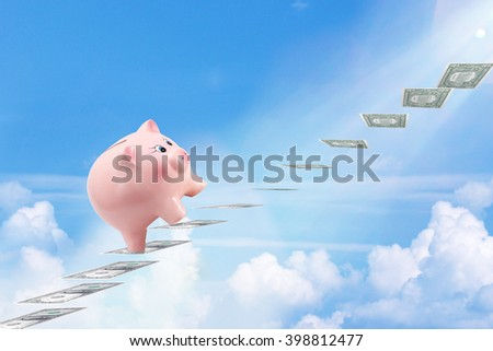 Pretty Piggy Bank Climbing Stairs for Success Made of Dollar Banknotes Above the Clouds - stock photo