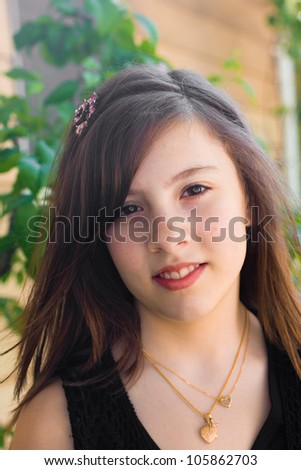 Pretty portrait of teenage girl outside - stock photo