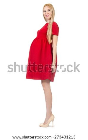Pretty pregnant woman in red dress isolated on white - stock photo