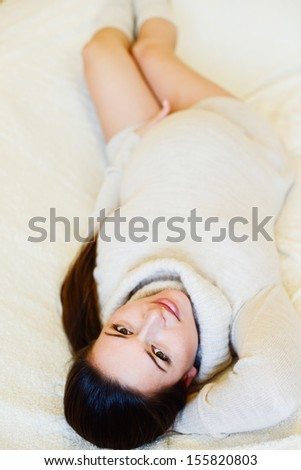 pretty pregnant woman laying on the sofa - stock photo