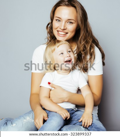 pretty real fashion mother with cute blond little daughter close up smiling - stock photo