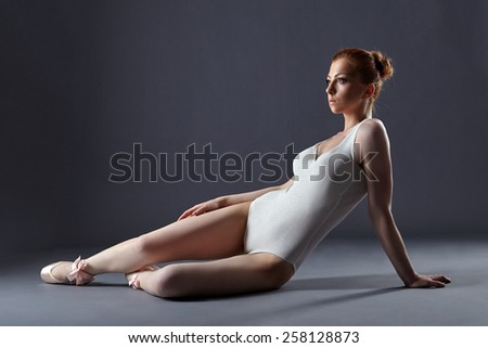 Pretty red-haired ballerina in shimmering leotard - stock photo