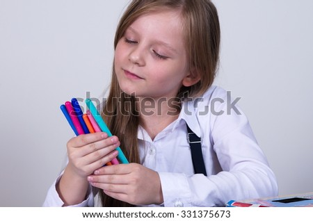 pretty school girl with colorful pencils.. - stock photo