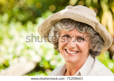 Pretty senior woman looking at the camera - stock photo