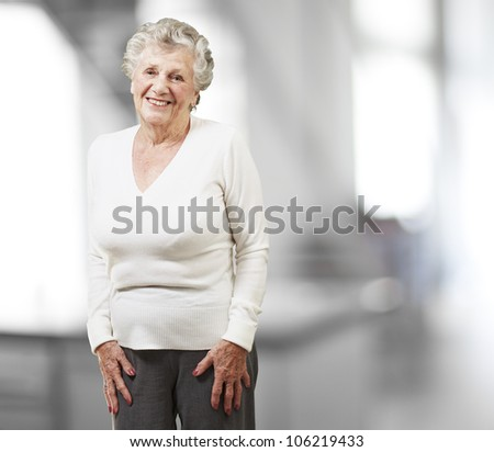 pretty senior woman smiling, indoor - stock photo