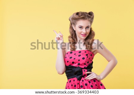 Pretty slim girl is presenting something interesting - stock photo