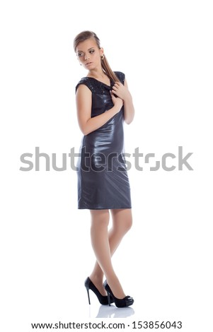 Pretty slim woman posing in trendy cocktail dress - stock photo