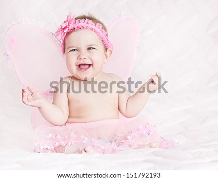 Pretty smiling baby  girl in butterfly costume on pink - stock photo