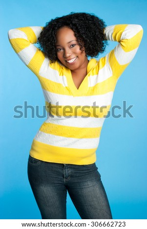 Pretty smiling black woman on blue background - stock photo