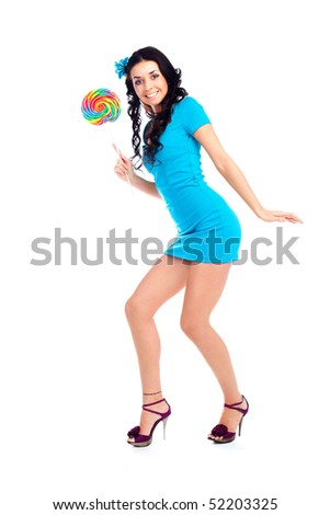 pretty smiling brunette girl with a lollipop in her hand - stock photo
