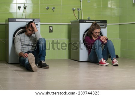 Pretty Smiling Couples In The Laundry Room - stock photo