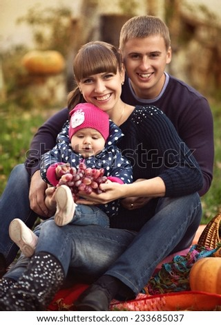 Pretty smiling family and daughter - stock photo