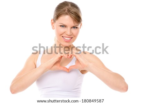 Pretty smiling girl showing heart shape, isolated on white background. Portrait of lovely young Caucasian woman in cotton underwear, healthy lifestyle concept.   - stock photo