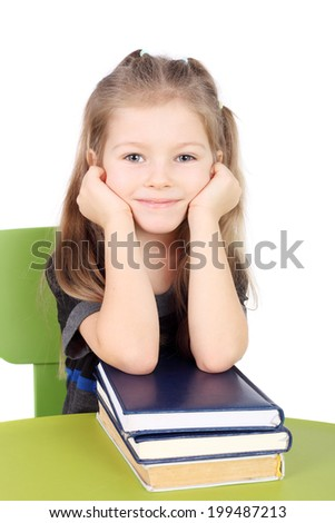pretty smiling little girl with the books - stock photo