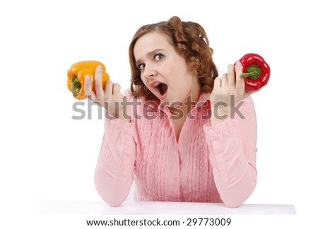 Pretty smiling woman holding a red sweet pepper. Girl is looking surprised. Housewife with sweet peppers. Isolated over white background. - stock photo