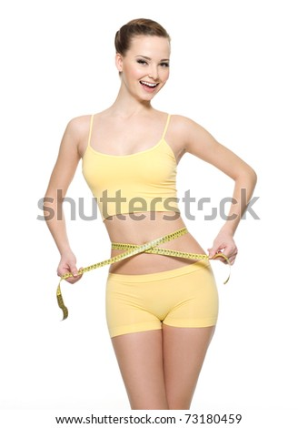 Pretty smiling woman measuring waist with  measurement type isolated on white - stock photo