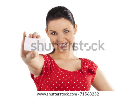 pretty smiling young woman in red dress with bussiness card against white background - stock photo