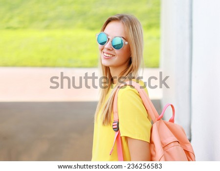 Pretty stylish smiling woman in sunglasses posing in summer, street fashion - stock photo