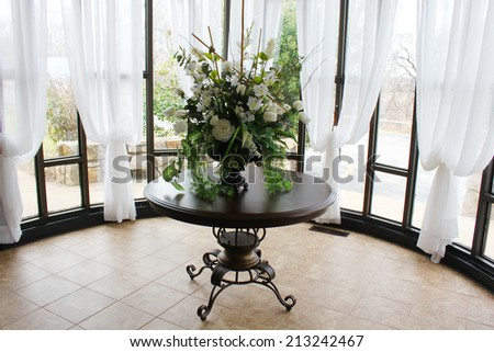 Pretty table and decorations in a wedding chapel - stock photo