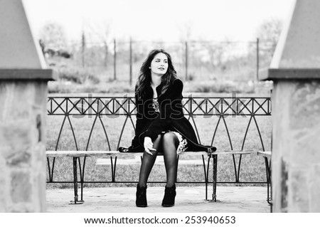 pretty teen girl sitting on the bench - stock photo