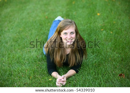 pretty teen girl with freckles outside - stock photo