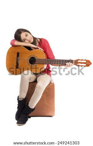 Pretty teenage girl and her guitar isolated over white background - stock photo