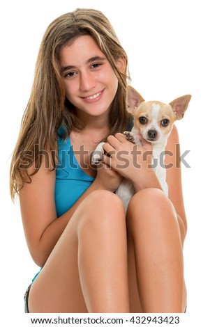 Pretty teenage girl and her small chihuahua dog isolated on a white background - stock photo